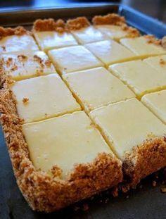 Creamy Lemon Squares -- homemade graham cracker crust with simply lemon filling.