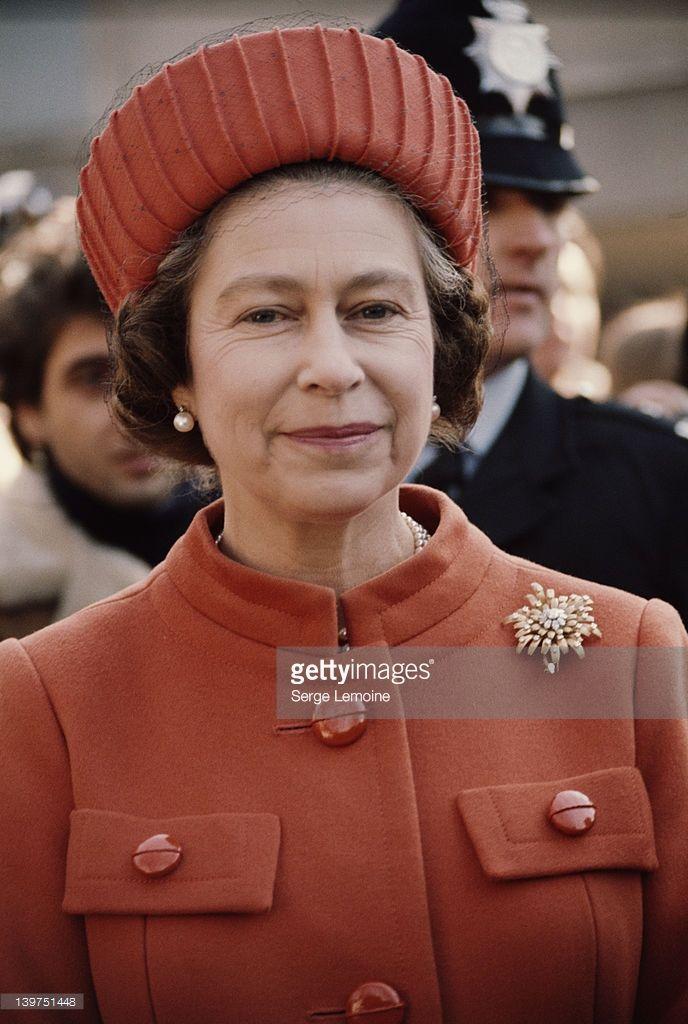 Queen Elizabeth II wearing an orange coat and hat, London, UK, circa 1977. (Photo by Serge Lemoine/Getty Images)