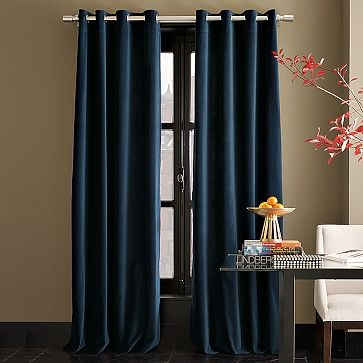 Love the color of the panels - and the silver rod/grommet combination. Just not keen on the idea of velvet curtains. Would love the fabric to be some type of silk or something lighter...