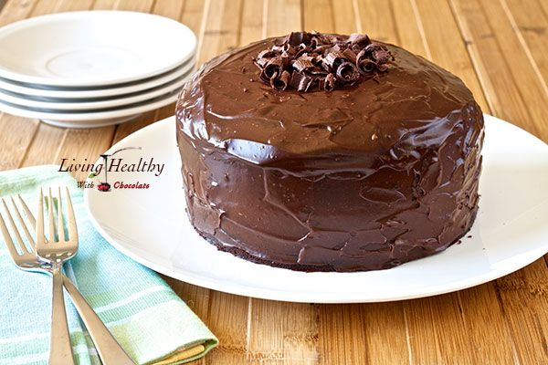 Light fluffy Paleo Chocolate Cake recipe (Grain, Gluten, Dairy Free) with chocolate frosting & ganache. This is the perfect birthday healthy chocolate cake.