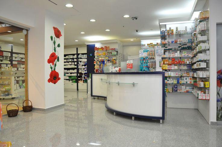 "Amenajare farmacia Ameris - Baneasa Jolie Ville Counter in forma de ""S"" oficina http://www.sertarefarmacii.ro/proiecte/16-farmacia-ameris-pharma-bucuresti"