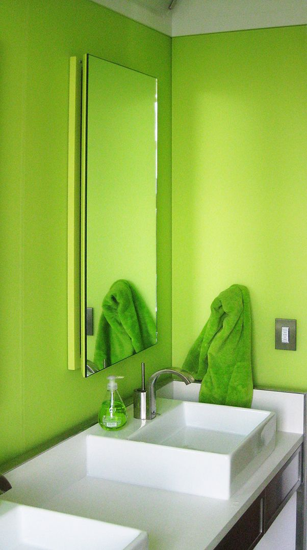Green etched glass in bathroom by Bendheim Architectural Glass