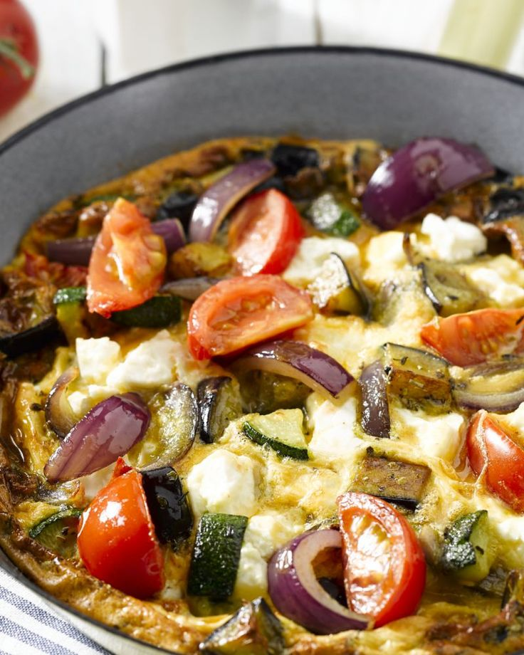 Oven Vegetable Omelet  ~2 eggplants, cubed 1 zucchini, diced 4 tomatoes, cut into wedges 1 red onion, finely chopped 2 cloves garlic, finely chopped 4 eggs 4 tbsp semi-skimmed milk 100g feta, crumbled 1 tbsp olive oil 1 small dried thyme 1 kl paprika pepper and salt