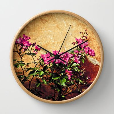 Pink flowers against weathered wall Wall Clock by Silvia Ganora - $30.00