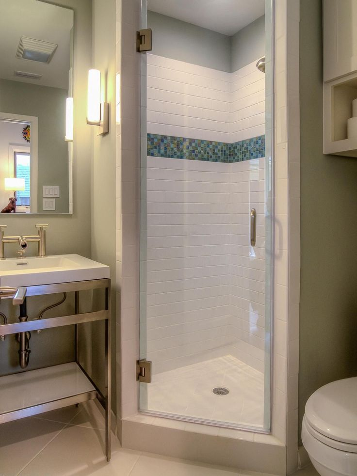 A Stall Shower Fits Perfectly In The Corner Of This Small Bathroom. Bright  White Tile