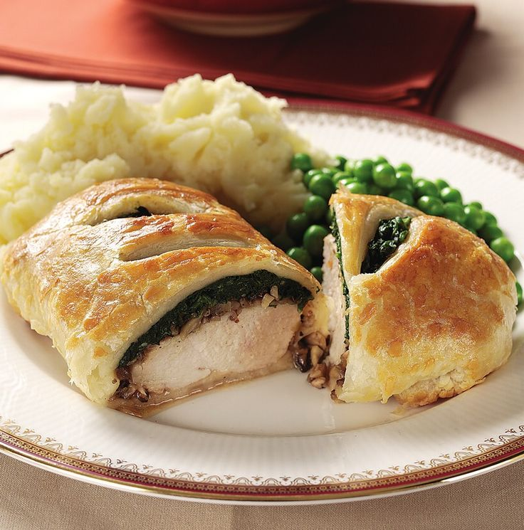 Treat your guests to these tempting puff #pastries filled with juicy #chicken breasts, spinach and mushrooms.
