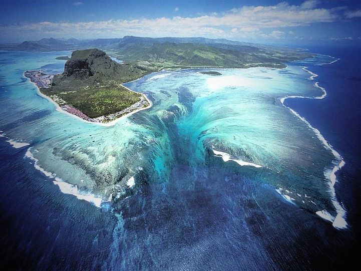 Approximately 1,200 miles off the southeast coast of Africa lies an island nation known as Mauritius that gives off the illusion of an underwater waterfall at the southwestern tip of the island.