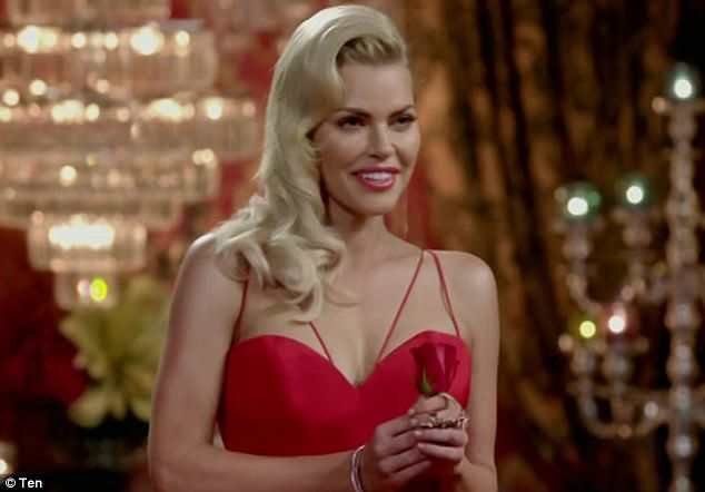 Glamorous: At the end of the evening she said goodbye to intruder Guy, while Ryan was elim...