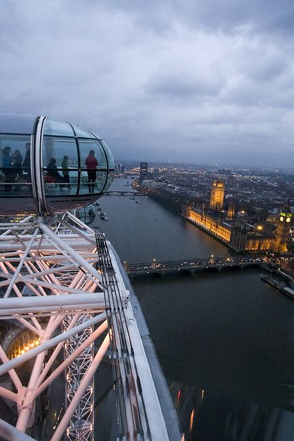 The London Eye is a giant Ferris wheel situated on the banks of the River Thames in London