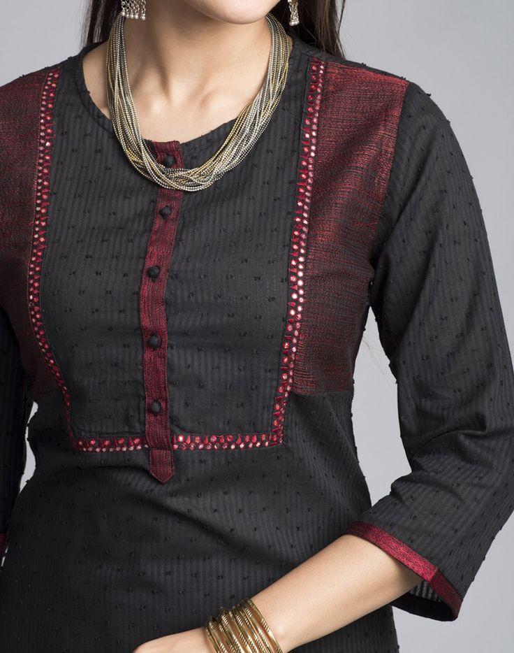 This appealing cotton long kurta in black can be worn anywhere. Itメs A-line round neck along with the embroidery is adding the dash of color to the piece. Itメs three quarter sleeves are comforting. One can pair this piece with a skirt, pants, palazzo or churidars. Also the look can be enhanced by pairing some fun jewellery from our vide collection.   Cotton Dobby Round Neck with Loop Button 3Q Sleeves A-Line Fit Hand Wash Separately in Cold Water
