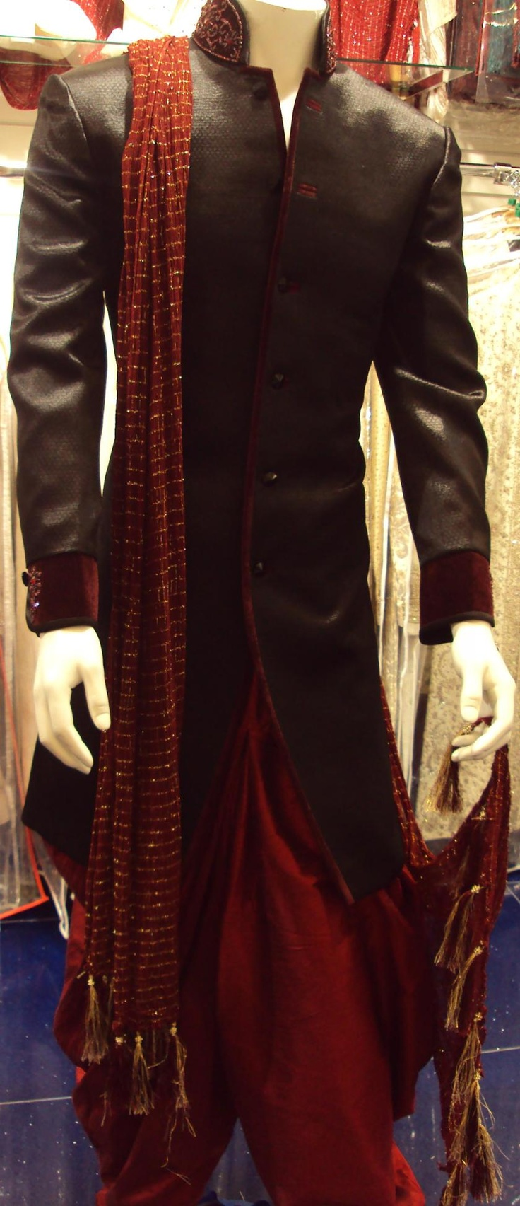 Men's sherwani. Black brockade with maroon piping. I'd wear the sherwani with churidar bottoms instead of the shalwar...Very nice!