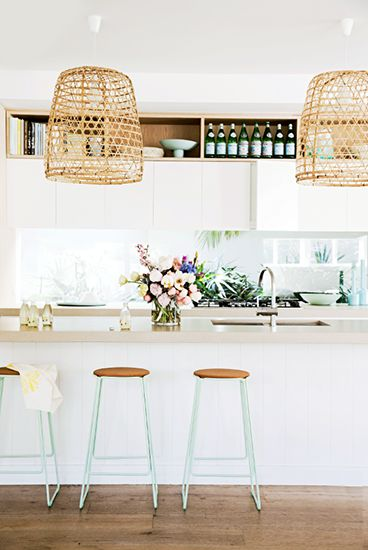 Stunning modern, coastal kitchen! White, timber shelving, aqua colour pops in stools and large cane pendants