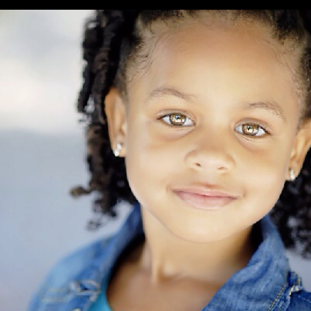 african american little girl with natural hazel eyes