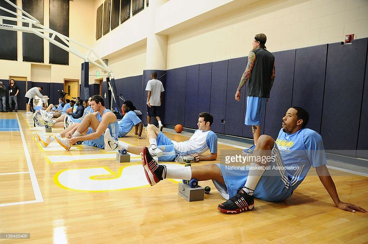 Andre Miller #24 and the Denver Nuggets stretch prior to practice on January 5, 2012 at the Pepsi Center in Denver, Colorado.
