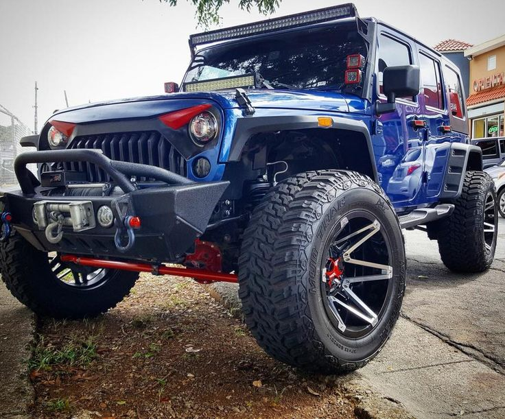Blue Jeep Wrangler with Custom Wheels and color  #jeep #jeepwrangler #jeepparts #jeepheadlights