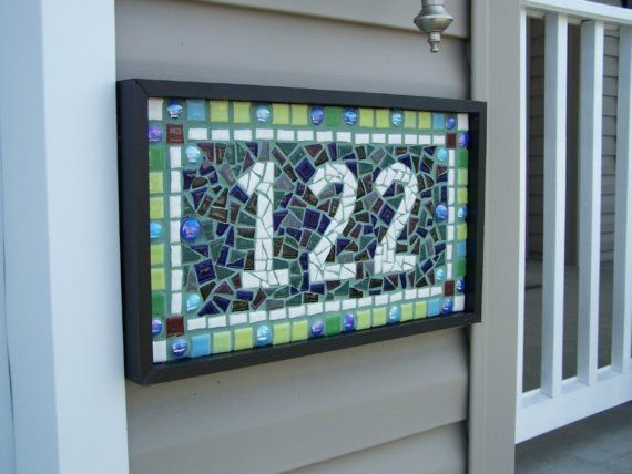 Mosaic house numbers.... although i think i would do last name, since we will probably move one day, plus you could pass it down to your children!