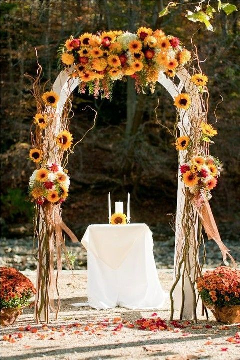 27 Fall Wedding Arches That Will Make You Say 'I Do!': #15. Fall-colored bold rustic wedding arch
