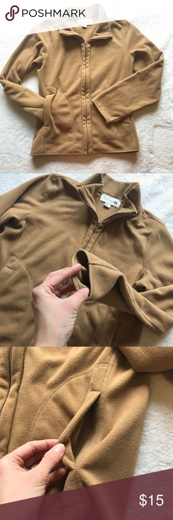 "Forever 21 Camel Zip Up Fleece Warm Pullover Superior condition - hardly worn! Pretty color. Soft fleece zip up with 2 front pockets and collar can be worn up or down. Color is as depicted. Bust - 40"" Length - 26"" Sleeves - 24"" Forever 21 Sweaters"