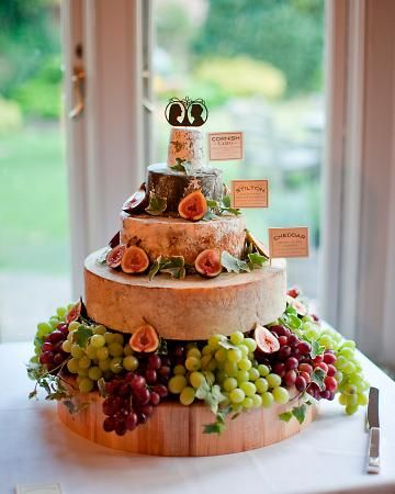 This couple seems to love cheese as much as I do!  Love this idea for a wedding cake - wheels of gourmet cheese.