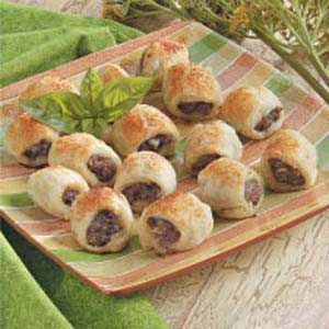 "Aussie Sausage Rolls - My guys LOVE these! ...And so easy. Instead of mixing the sausage mixture from scratch, I just use a 1# ""tube"" of pre-seasoned ground chicken sausage. (The kind that comes in packaging just like the Jimmy Dean pork sausage.)"