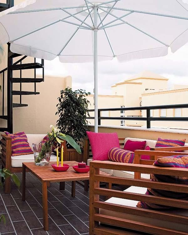 stylish balcony design with wooden patio furniture in pink