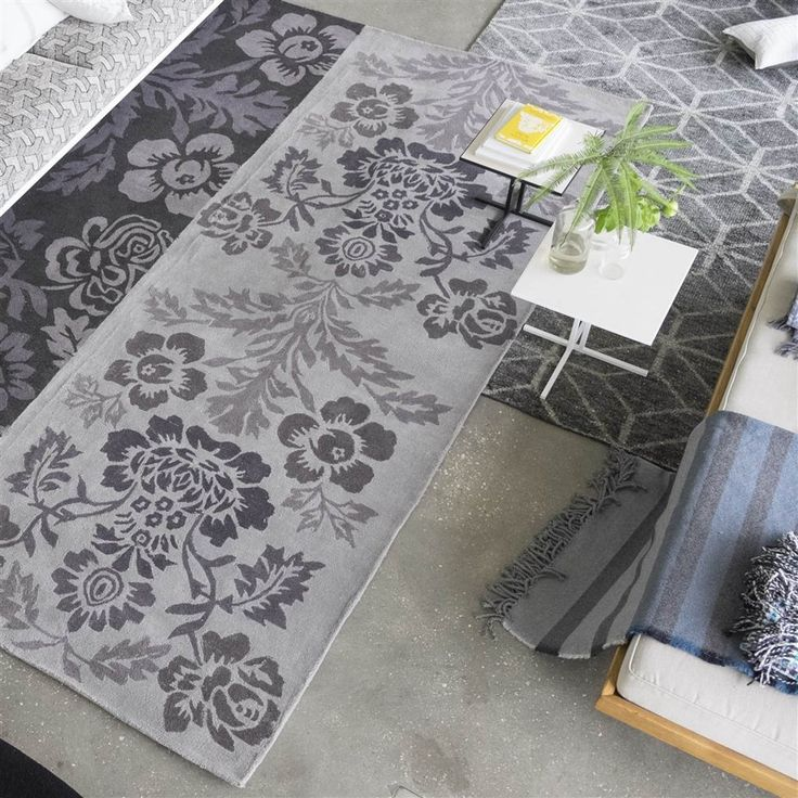 Damasco Slate Rugs features a fresco damask design in muted neutral greys and earth tones. the scrolling damask is distressed in places to reveal the basket weave cotton beneath, creating an vintage appearance with texture and character. #DesignerRugs #FloralRugs #InteriorDesign
