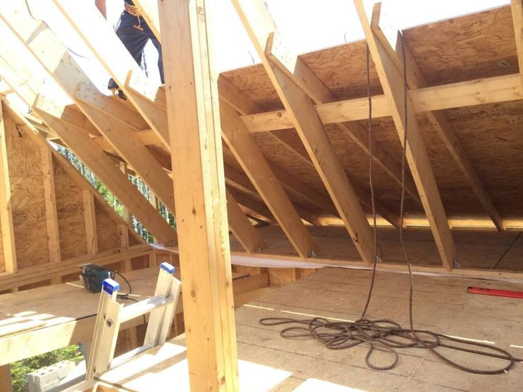 The-Off-Grid-Cabin-Roof-OSB-Sheathing-rear-cabin--half-complete