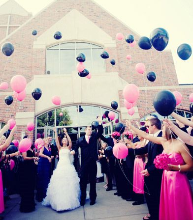 as the couple comes out let the balloons go instead of bubbles