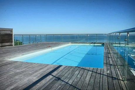 HORIZON BAY 104, Table View Beachfront Self Catering Accommodation in Cape Town - Enjoy the comfort of a two bedroom, seafront apartment within walking distances of the beach, pubs, restaurants, shops and more. Horizon Bay 104 is the perfect location for your next holiday.