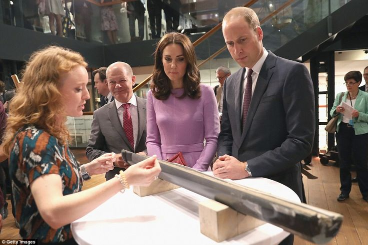 The couple are given a private tour of the museum with Hamburg MayorOlaf Scholz (second left) as they areshown a core sample from under the sea during their visit to the Maritime Museum today