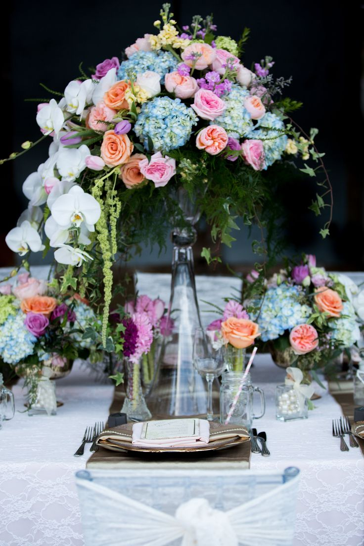 Blush and Gold. Photo by: Emily Exon Photography  www.emilyexon.com Flowers by: Flowers by Janie www.flowersbyjanie.com Venue: Azuridge Estate Hotel, Calgary/AB  Rentals/Decor: Great Events Rentals www.greateventsrentals.com Stationary by: Glimpze Invitations www.glimpze.ca #weddingdecor #flowers #chiavarichairs #chairsash #gold #blush #lace #chargers #masonjars #rustic #romance