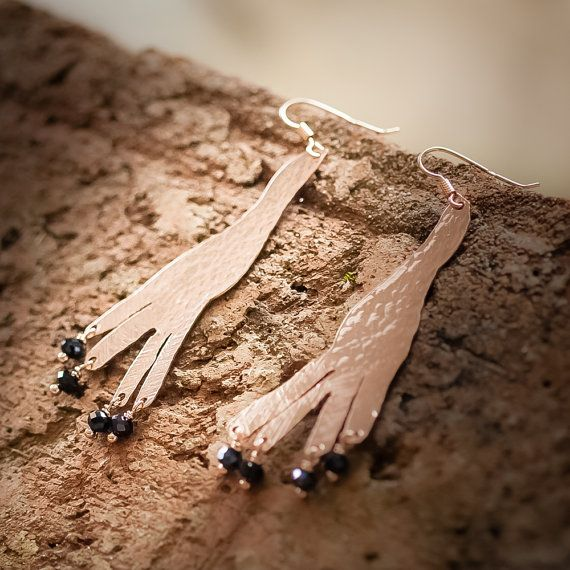 Earrings pair in hand hammered, 18K pink gold plated and vitrified copper, with black crystals.
