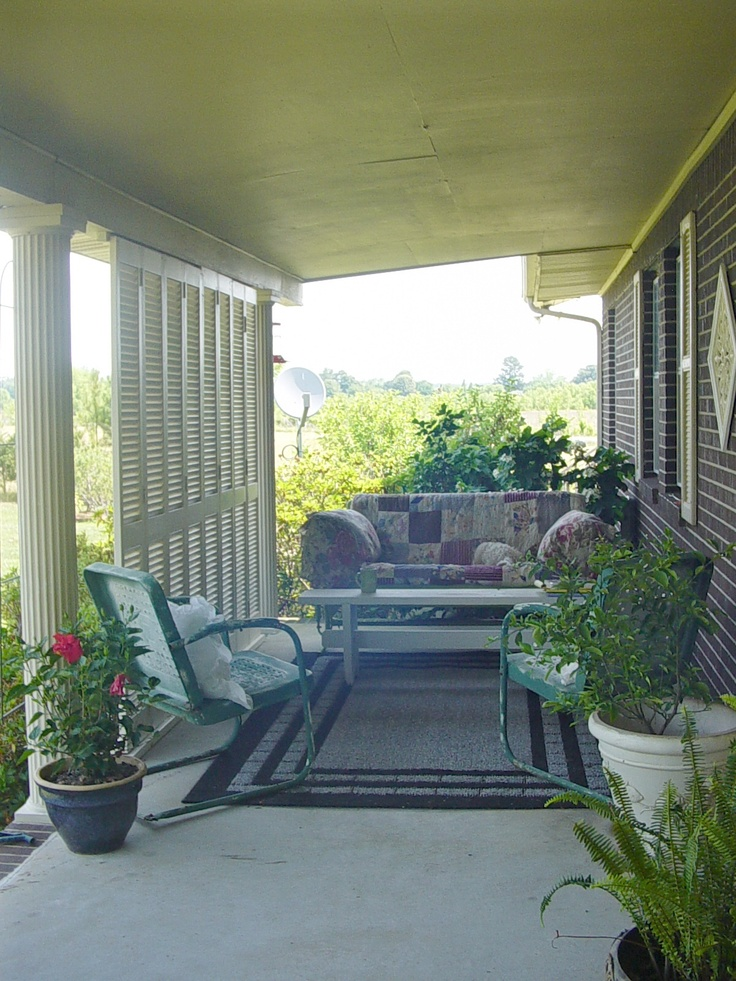 2.  My front porch.  Found louver doors at yard sale and we attached them at top and bottom to make a cozy room on the porch.  Added vintage glider, old quilt and pillows.  Great place to be on a nice day.