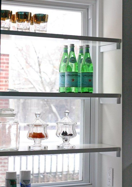 These window shelves in Design Manifest's new cottage kitchen are easy to do and a great way to eke out some storage — 10 DIY Space Saving Projects To Make This Weekend