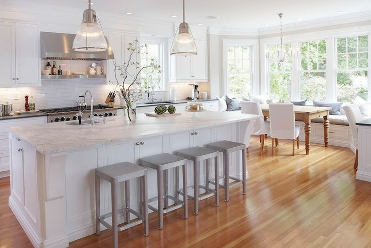 Classic white eat in kitchen.  Restoration Hardware Keynes Prism Pendants, marble, bay window banquette, farmhouse table |  Papyrus Home Design