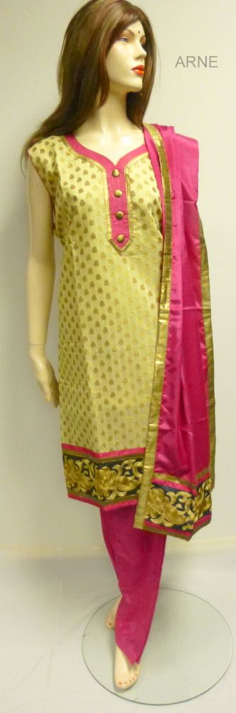 Size 44  - Gold yellow  Kameez in silk with gold buta print all over with pink  highlights with the neck and thread work embroidery on the border  - Pink silk Salwar and pink silk chiffon dupatta  - Sleeves attached