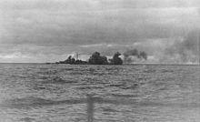 Bismarck firing her main battery during the battle