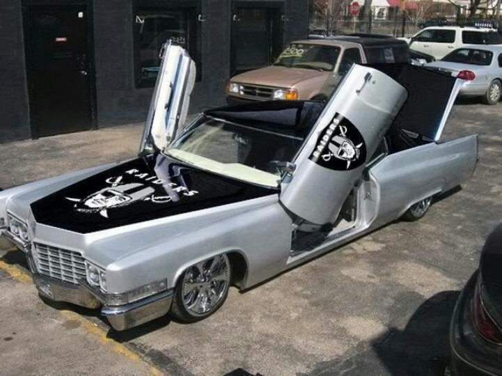 The Oakland Raiders obviously figure in to the appearance of this customised '60s Cadillac.