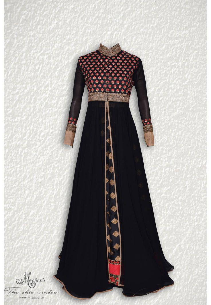 Ravishing black ensemble adorn in pretty butis at bodice complemented with benarasi skirt