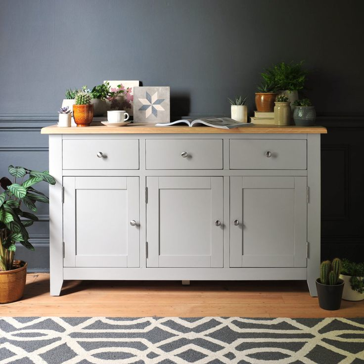 Click through to read the full article or Pin to save for later! Grey furniture, sideboard, painted furniture, tiles, grey walls