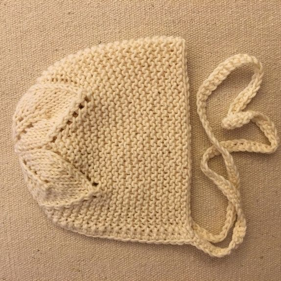 Garter stitch with leaves on crown baby bonnet.