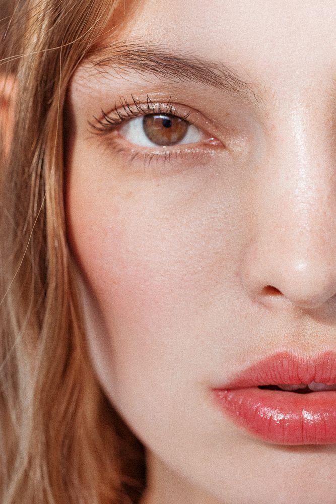 Simple makeup, glossy lip and minimal eye.