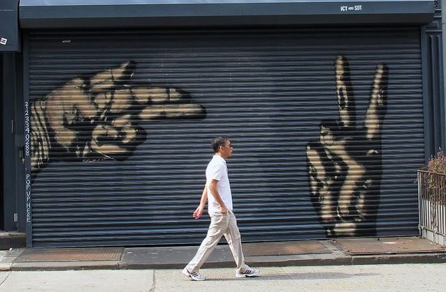 Soho / NY by s0t, an iranian stencil artist. He has used spray paint to grafitti on this shop gate.