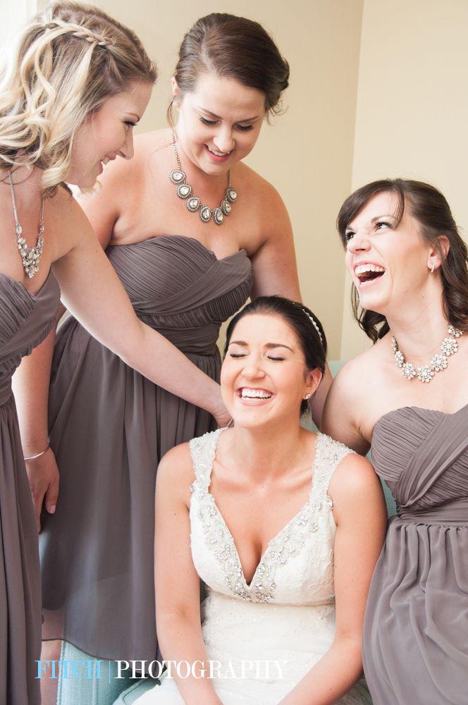 Bride and bridesmaids having so much fun getting ready!  #bride #bridesmaids #gettingready #weddingphotography