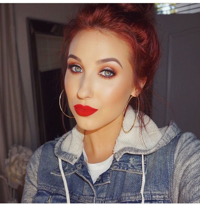Jaclyn Hill- LOVE this look! Red lips, warm eyes, && a bun!