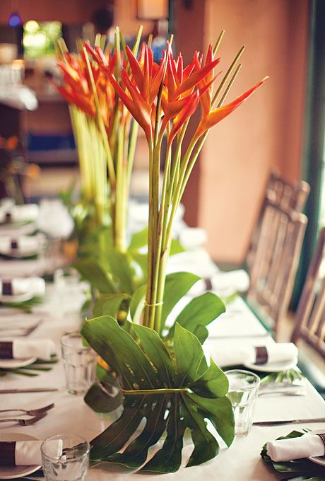 Brides.com: Flower Arrangements for a Destination Wedding. A Bird of Paradise Centerpiece for a Beach Destination Wedding  See more photos from this modern, tropical wedding in Florida.