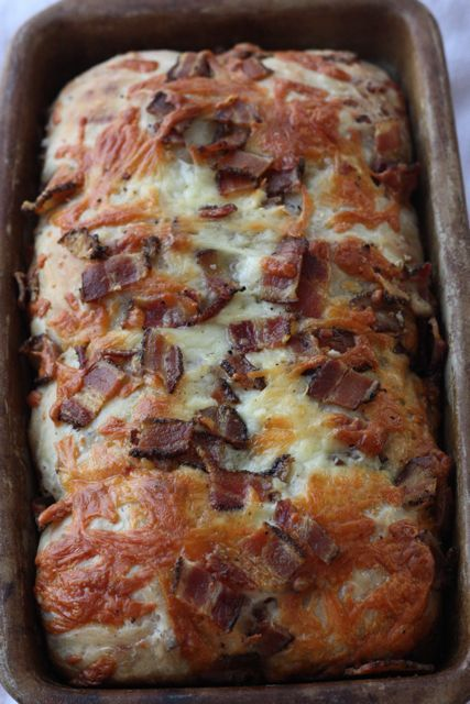Recipe for Loaded Bacon Cheddar Bread - A heap of freshly grated cheddar cheese and a pile of crispy thick cut bacon baked into a hearty loaf of bread that gives Panera a run for its money.