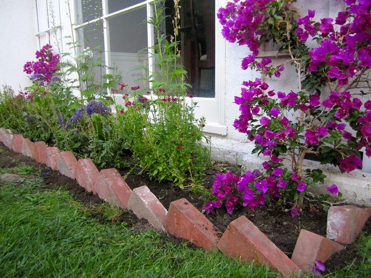 Bricks set on angle as garden border. Brick garden
