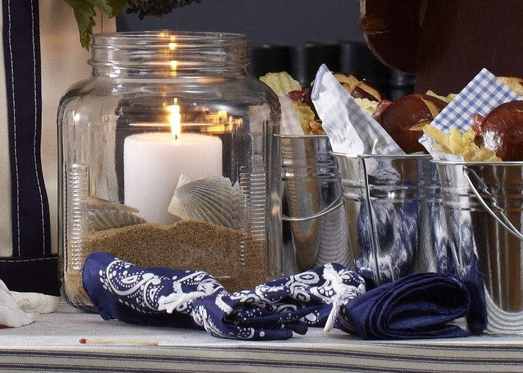 Candles with sand and sea shells. Bring a the beach to you and your baby shower guests.