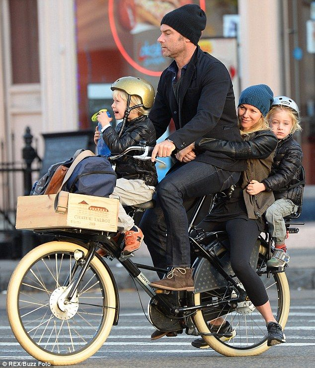 The more the merrier: Naomi Watts, Liev Schreiber, their sons Sam, far right, and Sasha, far left, all fit onto a three-seated bicycle as th...